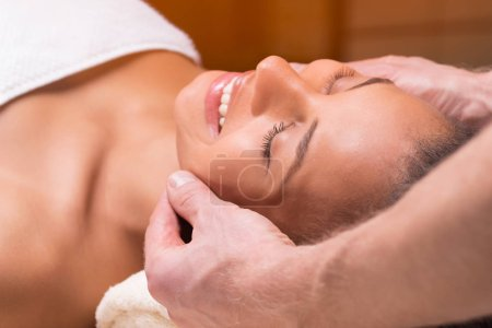 Beautiful woman having face massage