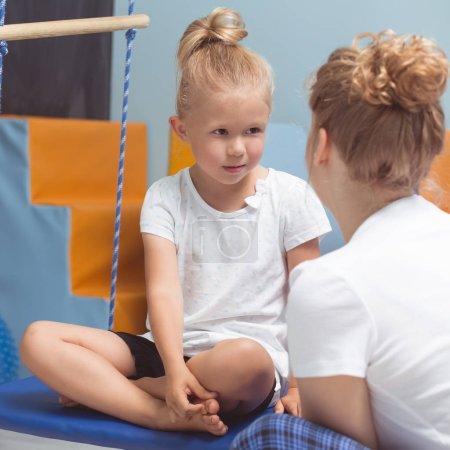 Teacher explaining exercises to kid