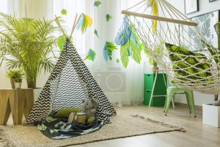 Room with tent and hammock