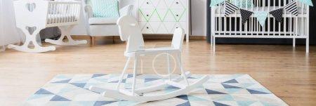 White minimalist furniture in nursery