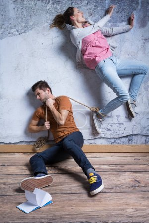 Man holding rope , toxing relationship