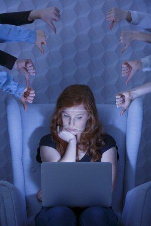 Sad girl using laptop