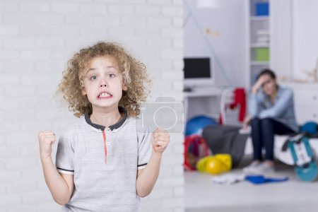 Young boy with bad mood
