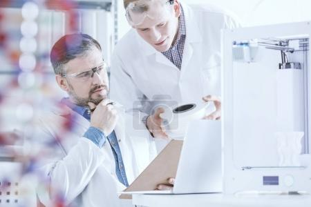 Scientists conferring in laboratory