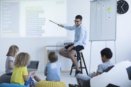 Teacher shows on an interactive whiteboard