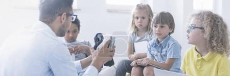Children discovering VR technology