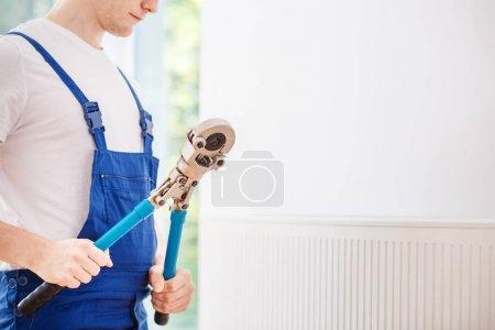 Handyman holding professional wrench