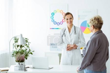 Smiling diet expert welcoming patient