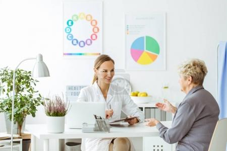 Smiling dietitian and patient
