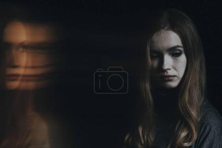 Photo for Young sad woman with split personality worrying about her condition - Royalty Free Image