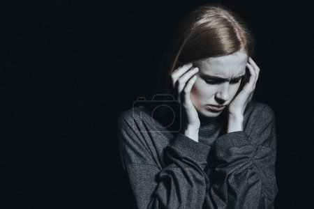 Photo for Young woman with depression and anxiety having a bad headache - Royalty Free Image