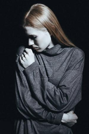 Photo for Young lonely lady in grey sweater feeling cold - Royalty Free Image