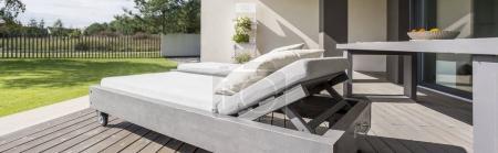 Wooden sunbed on terrace