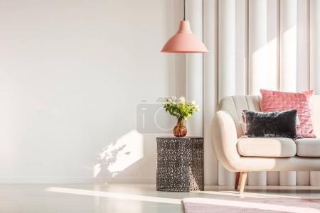 Photo for Metal table next to white sofa in bright living room interior with copy space - Royalty Free Image