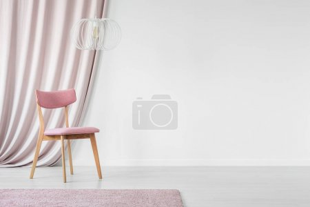 Chair in empty wall