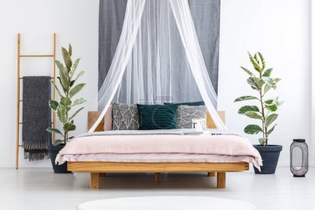 White veil over wooden bed