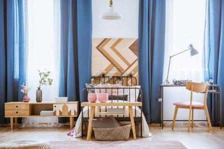 Wooden chair in teenager's bedroom