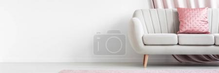 Photo for Empty living room interior with pink pillow on beige couch, against white wall - Royalty Free Image