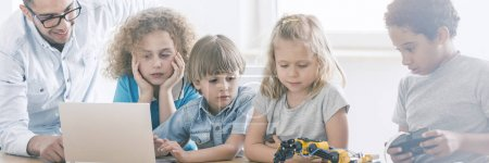 Photo for Elementary school pupils learning about coding and robotics in a modern computer science lab - Royalty Free Image