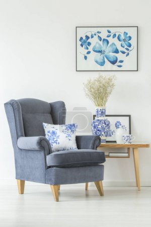 Comfy armchair in white room