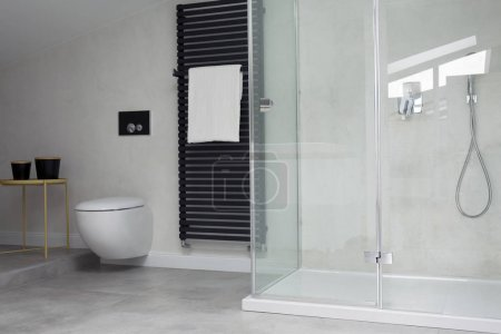 Glass shower in bright bathroom