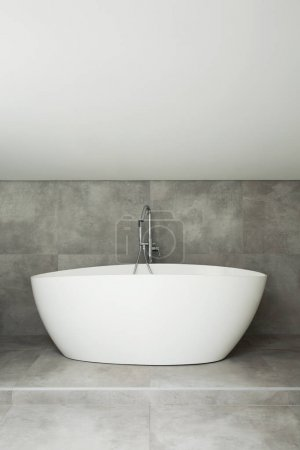 White bathtub in simple bathroom