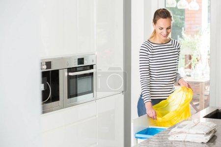 Woman preparing bin for segregation