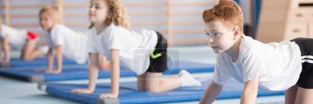 Young boy during corrective gymnastics