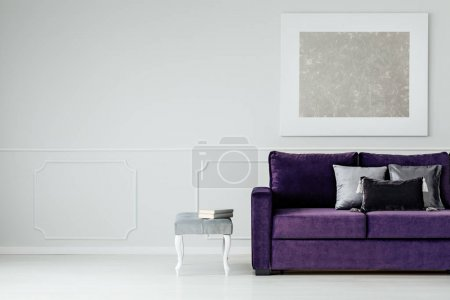Photo for Silver cushions on purple couch against grey wall with painting in living room interior with copy space - Royalty Free Image