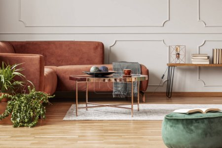 Photo for Stylish copper colored coffee table in front of comfortable corner sofa in trendy living room - Royalty Free Image