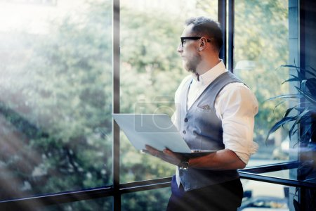 Businessman Holding Modern Laptop