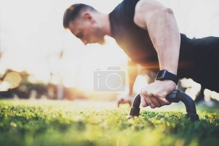 athlete exercising push up outside