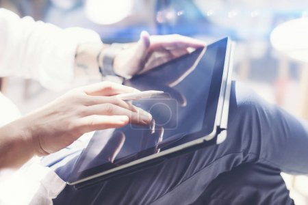 man using electronic pen and tablet