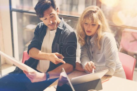 two entrepreneurs working on laptop