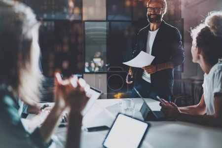 Photo for Business people brainstorming concept photo.Coworkers working at night office.Horizontal, flares effect.Blurred background - Royalty Free Image