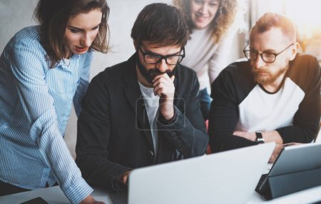 Photo for Young team working together in meeting room at office.Coworkers brainstorming process concept.Horizontal.Blurred background. - Royalty Free Image