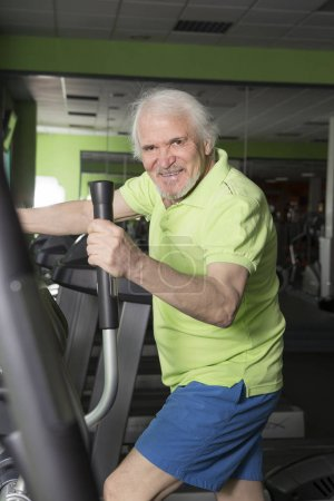 Elderly man in the gym