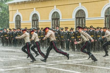 KYIV, UKRAINE - May 26, 2017: The graduation ceremony at the Kiev military lyceum of Ivan Bohun ends with a strong spring shower.