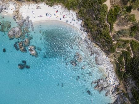 Paradise of the sub, beach with promontory overlooking the sea. Zambrone, Calabria, Italy. Diving relaxation and summer vacations. Italian coasts, beaches and rocks. Aerial view