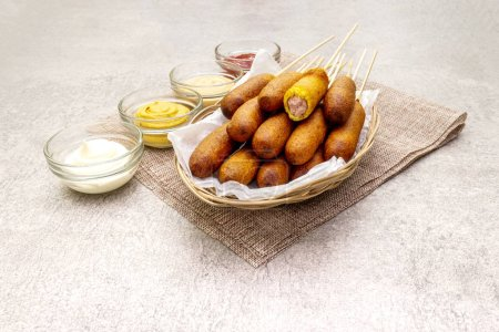 Corn dogs homemade with popular sauces. Traditiona...
