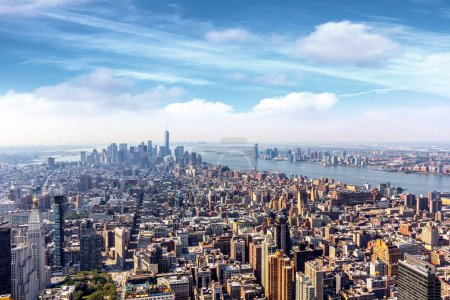 cityscape of Manhattan under blue sky with clouds, New York City, USA