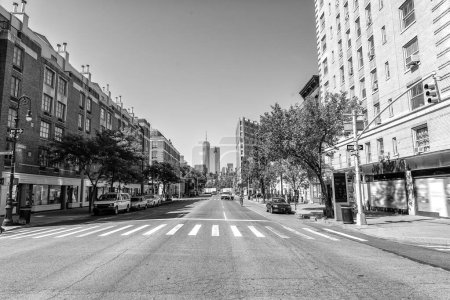 Photo for In the streets of South Manhattan, in the distance the most famous skyscrapers of New York. - Royalty Free Image