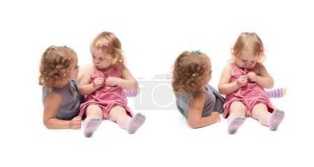 Couple of young little girl sitting over isolated white background