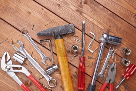 Set of different work tools on wooden surface