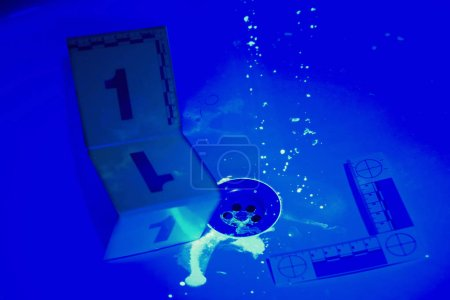 Wash basin in bath room with invisible stains of blood under UV light