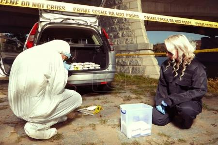 Photo for Police seized lot of drugs found in abandoned car with dead dealer - Royalty Free Image