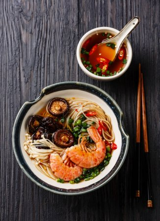 Photo for Ramen noodles with prawns and shiitake mushrooms on dark wooden background - Royalty Free Image