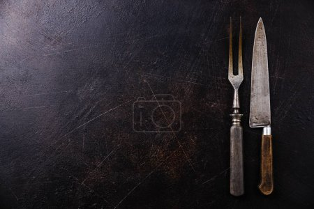 Meat fork and kitchen knife