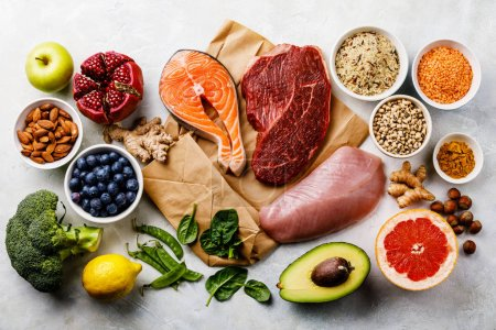 Photo for Balanced diet Organic Healthy food Clean eating selection Including Certain Protein Prevents Cancer: fish, meat, fruits, vegetables and cereal - Royalty Free Image