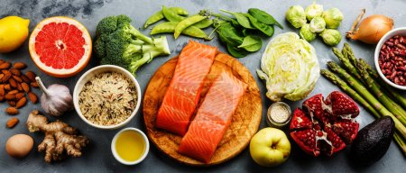Photo for Healthy food clean eating selection: fish, fruit, vegetables, cereal, leaf vegetable on gray concrete background copy space - Royalty Free Image
